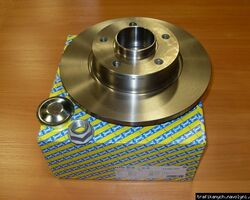 Тормозной диск задний с подшипником SNR на 1.9 / 2.0 / 2.5dci - RENAULT TRAFIC / OPEL VIVARO